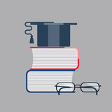Graduation Cap on Book Stack with glasses. Graduation icons Royalty Free Stock Photography