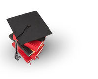 Graduation cap and book. Graduation cap on top of a stack of books Stock Photography
