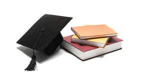 Graduation cap and book Royalty Free Stock Image