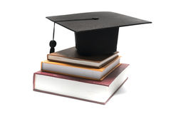 Graduation cap and book Royalty Free Stock Images