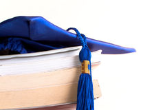 Graduation cap and books. Isolated on white Royalty Free Stock Images