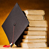 Graduation cap and books. Graduation cap and old books Royalty Free Stock Photos