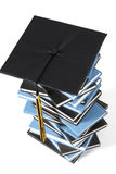 Graduation cap and books. On white background Stock Photos