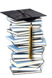 Graduation cap and books Royalty Free Stock Images
