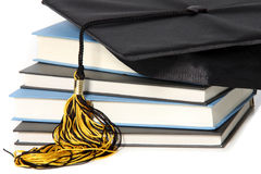 Graduation cap and books Stock Photos