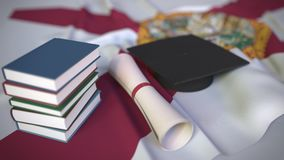 Graduation cap, books and diploma on the flag of Florida. Higher education in the USA related conceptual 3D animation