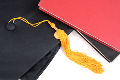 Graduation Cap and Books. School books and graduation cap white background Royalty Free Stock Photo