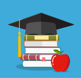 Graduation cap on books stacked, Royalty Free Stock Images