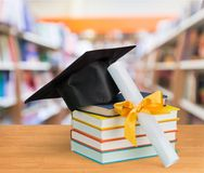 Graduation cap and books on table. Background hat achievement business study horizontal Stock Photography