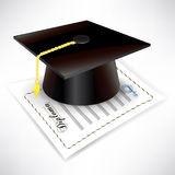 Graduation cap with diploma Royalty Free Stock Image