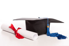 Graduation cap and diploma. Isolated royalty free stock images