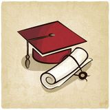 Graduation cap and diploma old background Royalty Free Stock Image