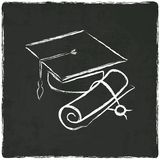 Graduation cap and diploma on old background Royalty Free Stock Images