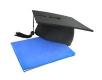 Graduation cap with diploma Royalty Free Stock Photos