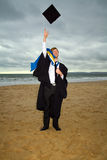 Graduation in cap and gown Royalty Free Stock Photo