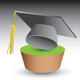 Graduation cap on green patch Royalty Free Stock Images