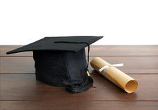 graduation cap, hat with degree paper on wood table Empty ready Royalty Free Stock Photography