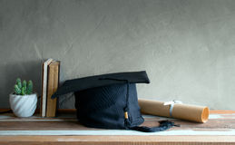 Graduation cap, hat with degree paper on wood table graduation c Royalty Free Stock Image