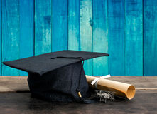 graduation cap, hat with degree paper on wood table, vintage woo Stock Images