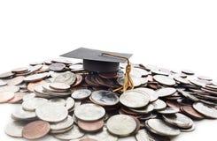 Graduation cap on money pile Stock Photos