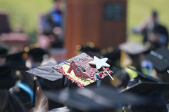 Graduation cap, Northwestern Oklahoma State University. May 6, 2017, graduation commencement on the football field in Alva, Oklahoma. Decorated graduation cap Stock Photos