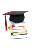 Graduation cap on stack of books Stock Photography