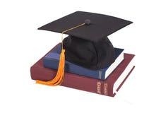 Graduation Cap On stuck of Books. Isolated Stock Photo
