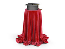 Graduation cap on table covered cloth Royalty Free Stock Photos
