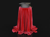 Graduation cap on table covered cloth Stock Image