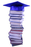 Graduation cap on top of book stack Stock Images