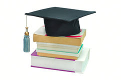 Graduation cap on top of a stack of books. Isolated on white Royalty Free Stock Photos