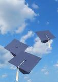 Graduation caps. Graduation hats on natural sky Royalty Free Stock Photos