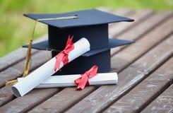Graduation caps with certificates Stock Photos