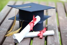Graduation caps with certificates Royalty Free Stock Image