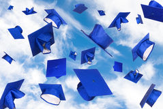 Graduation caps in flight Stock Images