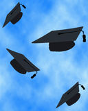 Graduation Caps Flying Stock Images