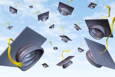 Graduation caps thrown in the air Royalty Free Stock Photography