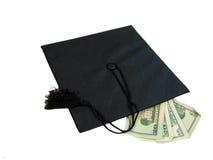 Graduation Cash. A black graduation cap with 10 & 20 dollar bills, over white Stock Image