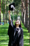 Graduation Celebration. The girl the graduate of university holds a cap in a hand Stock Images