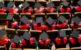 Graduation celebration. Up view on students sitting stock photography