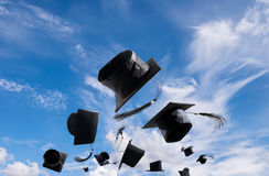 Graduation Ceremony, Graduation Caps, hat Thrown in the Air with Stock Images