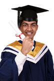 Graduation with clipping path. Young Indian graduation picture isolated with clipping path Stock Photos