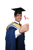 Graduation with clipping path. Young Indian graduation picture isolated with clipping path Stock Images