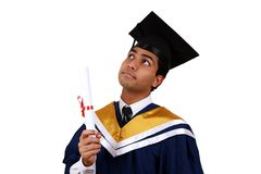 Graduation with clipping path. Young Indian graduation picture isolated with clipping path Stock Photo