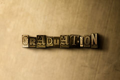 GRADUATION - close-up of grungy vintage typeset word on metal backdrop Stock Photo