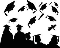 Graduation Commencement. Silhouettes of graduates at commencement, with the customary mortarboard toss and chat Stock Photo