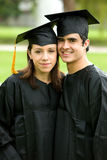 Graduation couple of students Royalty Free Stock Photos