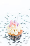 Graduation cupcake with mortar board confetti Stock Photos
