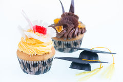 Graduation cupcakes with mortar board close-up Stock Images