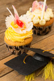 Graduation cupcakes with mortarboard close-up Royalty Free Stock Photo